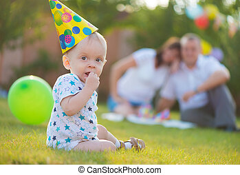 Little baby in cap on his birthday