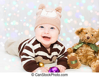 20a70997b1339 Little baby boy in elf hat with fairy lights. Little baby boy in elf ...