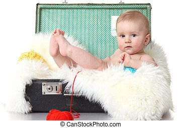 Little baby in vintage suitcase isolated on white
