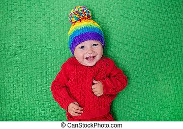 Little baby in warm knitted hat - Cute baby in warm wool...