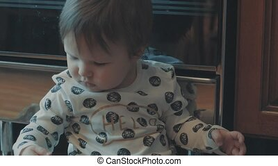 Little baby playing with onion