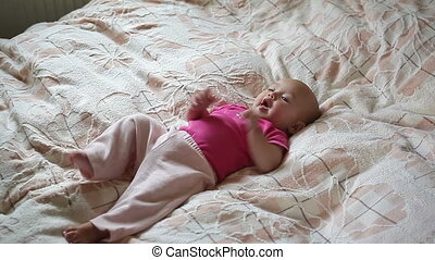 little baby lying on the bed