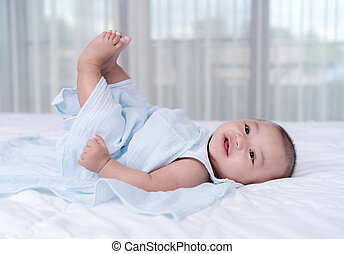 baby move leg in the air on a bed