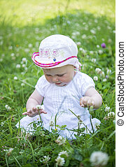 little baby playing in the grass