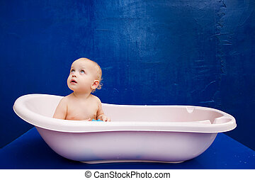 little baby sitting in the bath