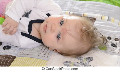 Little baby smiling - Little Girl lying on his back and...