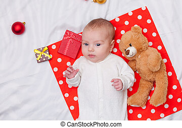 little baby with christmas gifts