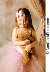 Little ballerina beauty hugging teddy bear - Adorable little...