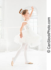 Little ballerina girl in a tutu. Adorable child dancing...