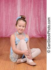 little ballerina girl sitting