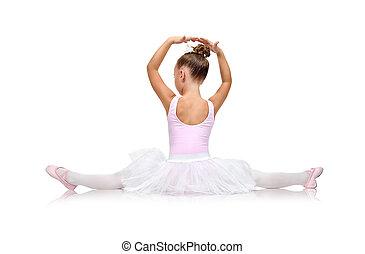 ballerina in tutu sitting on floor