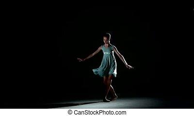 little Ballerina posing in blue dress on Black