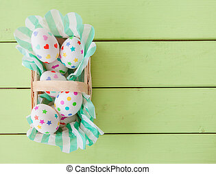 Little basket with easter eggs