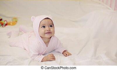 Little beautiful baby girl in pink bear costume