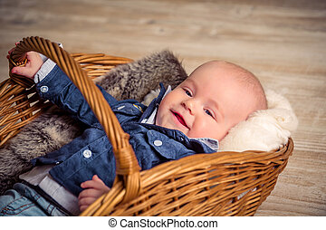 little beautiful child in the basket