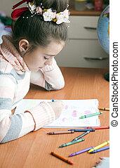 beautiful girl draws