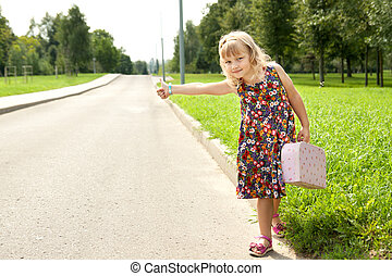 Little beautiful girl on the road