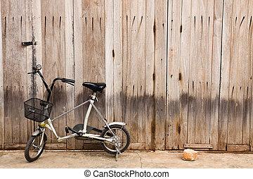 little bicycle with wood door