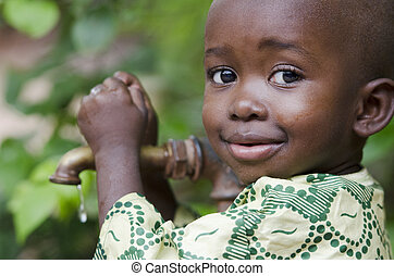 Little black boy asking begging for clean water. Its...