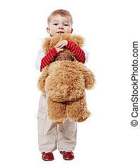 boy hugging bear