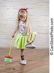 Little Blond Girl Doing Household Chores Alone