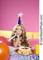 little blond girl  in a birthday party