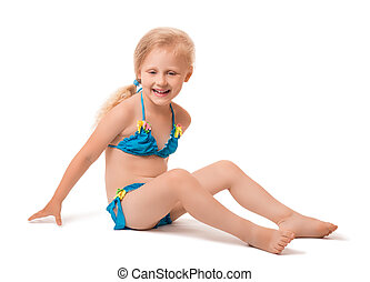 Little blond girl in a swimsuit isolated on white
