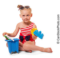 Little blond girl in bathing suit, sunglasses with toys isolated.