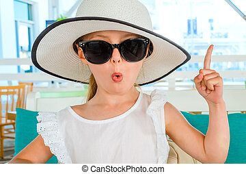 Little blond girl in black sunglasses