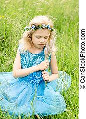 little blond girl in blue dress