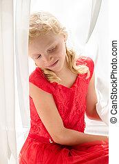 little blond girl in red dress