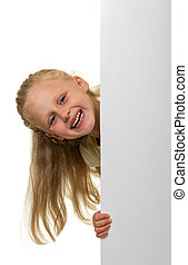 Little blond girl peeking out from behind a banner isolated on white