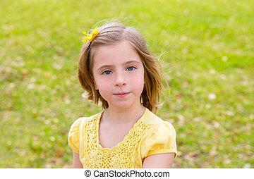 little blond girl portrait in park