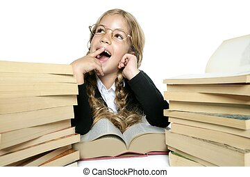 little blond girl smiling with a lots of books