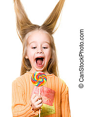Little blond girl with a candy