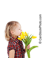 Little blond girl with yellow tulips