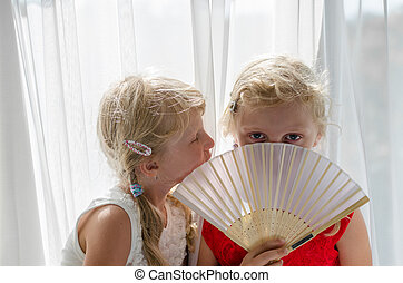 little blond girls in red and white dress with fan