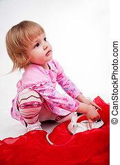 little, blond hair girl ironing