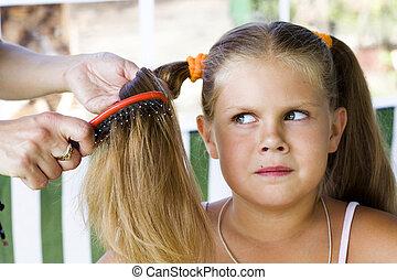 haircare - Little blond long hair girl has haircare by...