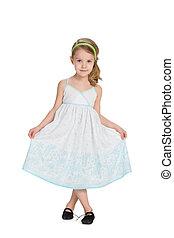 Little blonde girl in a dress