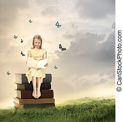 Little Blonde Girl Reading a Book  on Top of Books