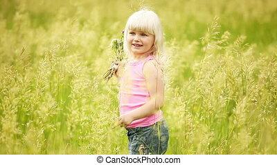 Little blonde walking in the park w