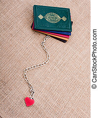 Little books attached to a heart with a chain