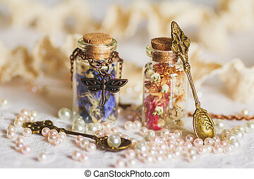 Little bottle full with colorful dried flowers