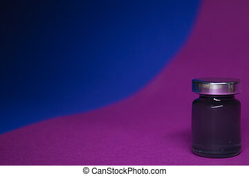 Little bottle with black liquid on blue-pink background. Isolated.