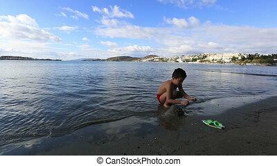little boy 1 - little boy playing on the beach