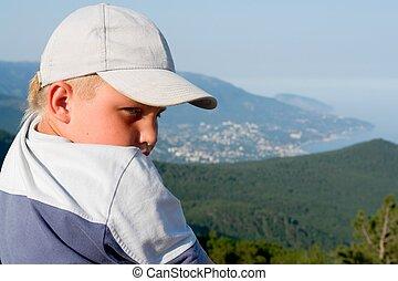 boy against mountains