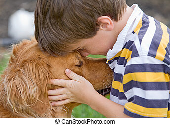 Little Boy and Dog - Little Boy Being Affectionate with his...