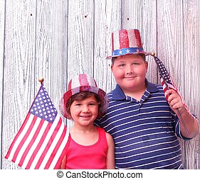 Little boy and girl celebrating 4th of july