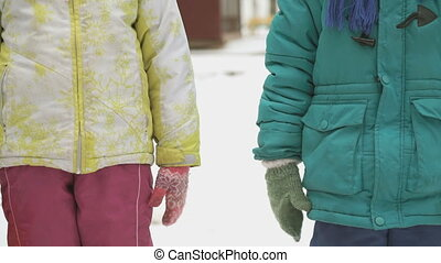 Little boy and girl holding hands friendly